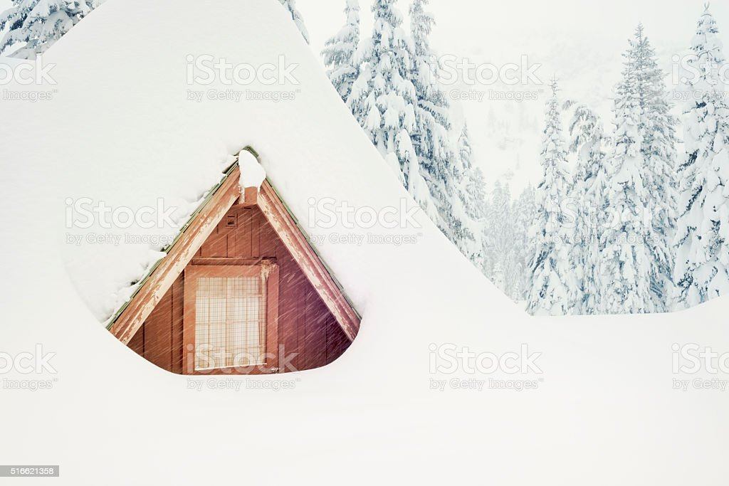 Snowed in for the Winter Weather Thick snow covers the roof Cold Temperature Stock Photo