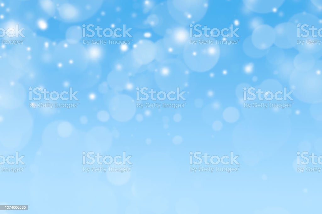 Snowfall Against A Blue Background stock photo