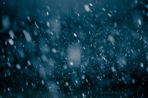 Snowfall against black background.