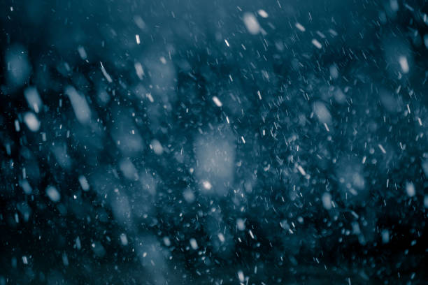 Snowfall against black background. Snowflakes against black background for adding falling snow texture into your project. Add this picture as