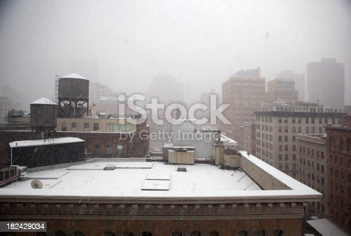 a snowstorm in New York looking downtown in Tribeca .