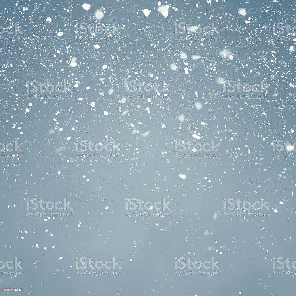 Snowfall with Light Blue Background stock photo