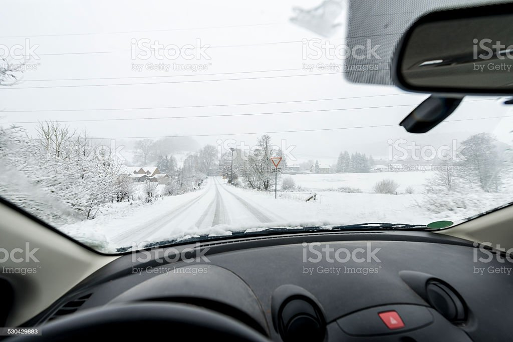Snowfall,Country Road driving stock photo