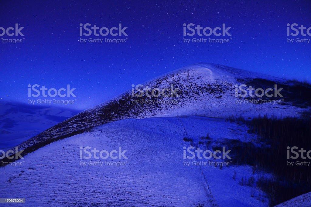 snowfield in night sky stock photo