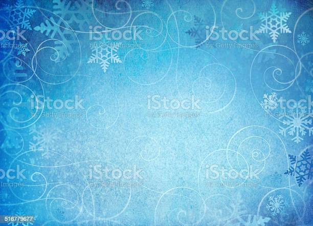 Photo of Snowflake background with swirl accents.