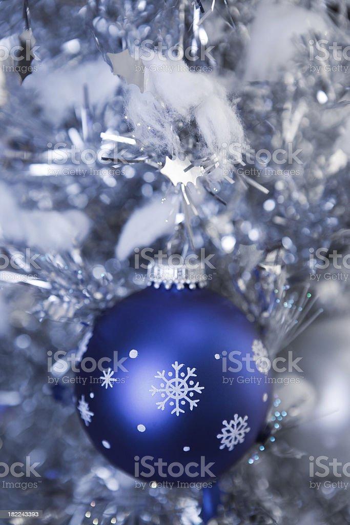 Snowflake Christmas Ornament Hanging on Metallic Tree royalty-free stock photo