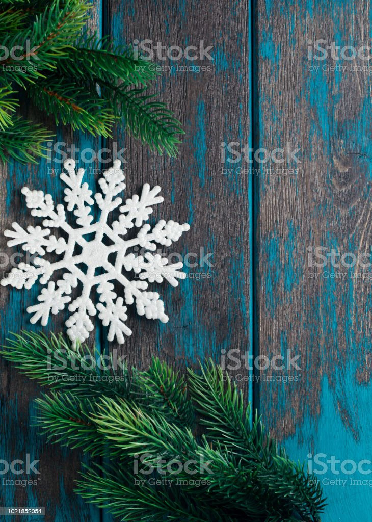 Snowflake christmas tree toy on wooden rustic desk. Christmas decoration. stock photo