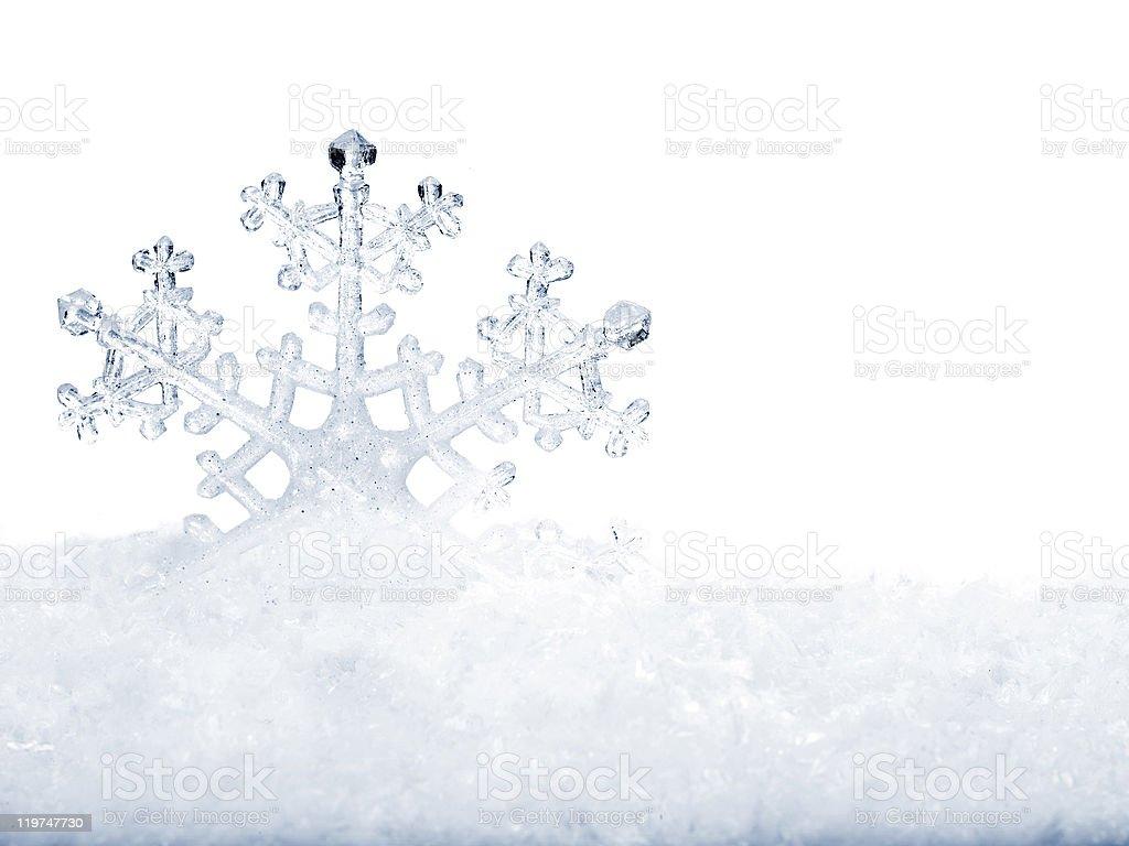 Snowflake in white snow. stock photo