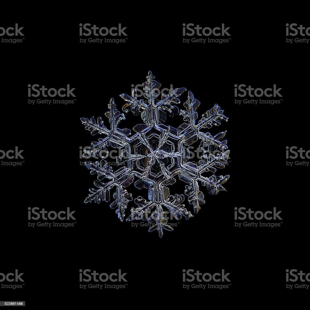 Snowflake isolated on black background stock photo