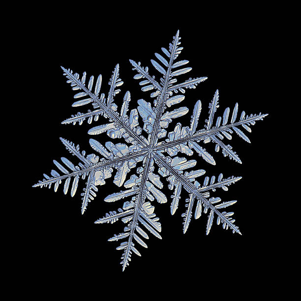 snowflake isolated on black background - ice crystal stock pictures, royalty-free photos & images