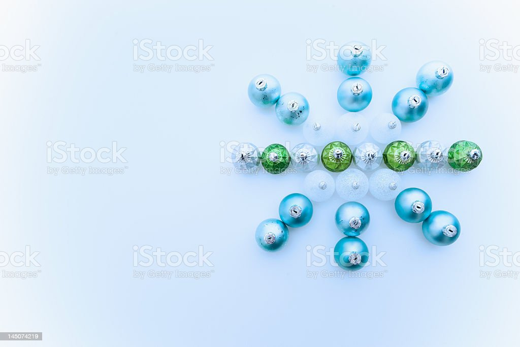 Snowflake made of christmas baubles stock photo