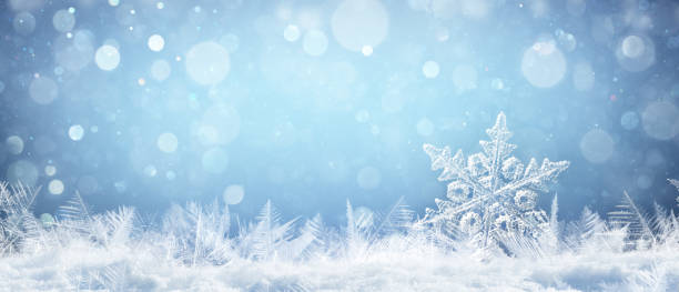 snowflake on natural snowdrift close up - christmas and winter background - snowflake background stock pictures, royalty-free photos & images