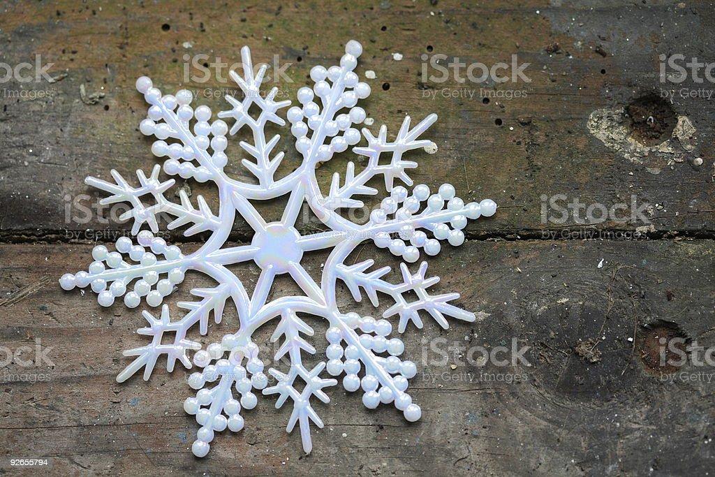 Snowflake on wood royalty-free stock photo