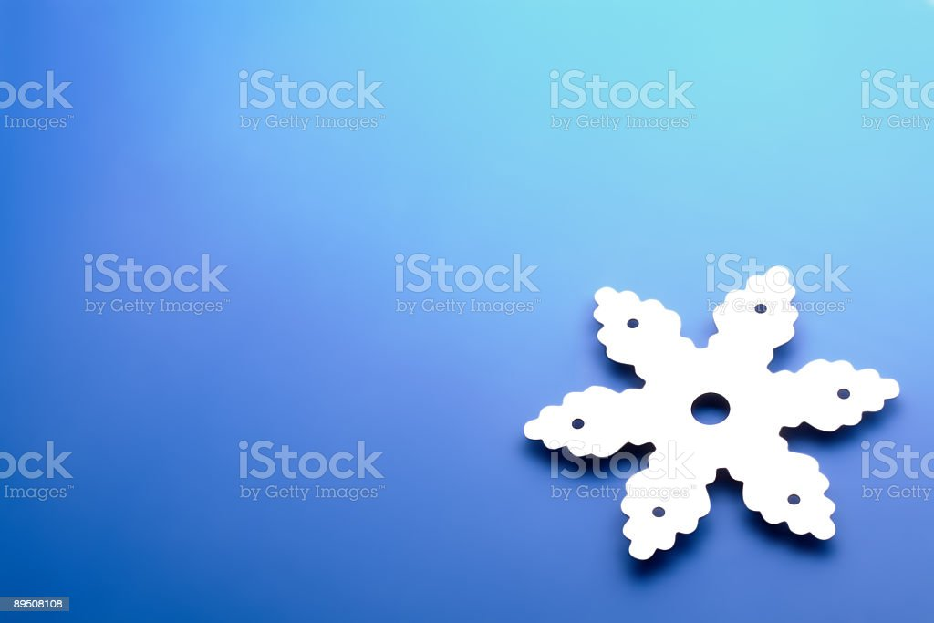 snowflake over blue royalty-free stock photo