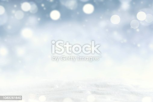 847752786 istock photo Snowflakes and snowfall on a cold blue winter background. 1083261840