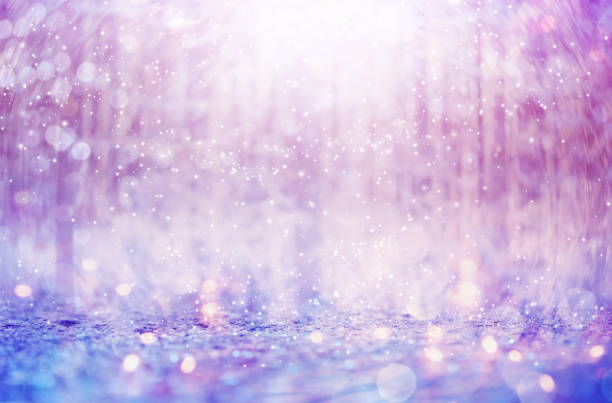 snowflakes on an abstract shiny light background - ethereal stock pictures, royalty-free photos & images