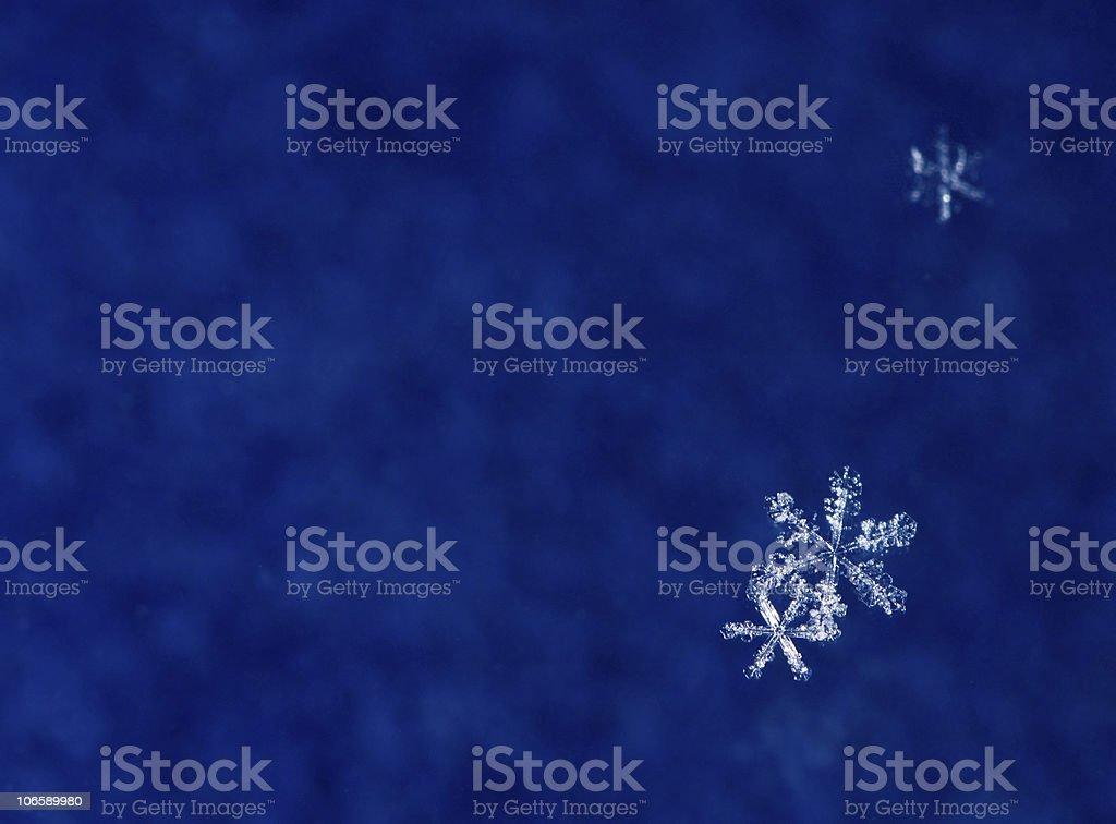 Snowflakes on blue background royalty-free stock photo