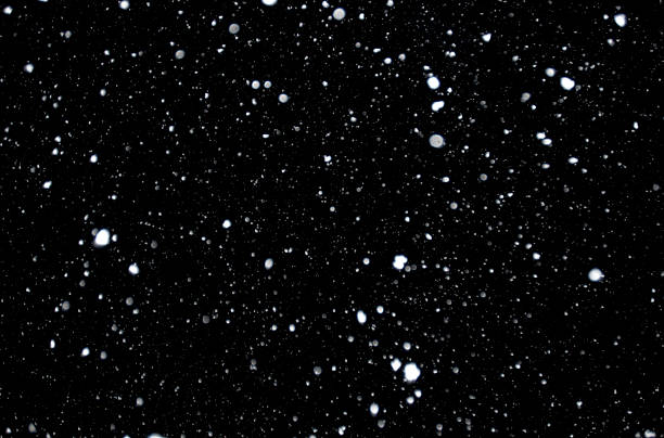 snowflakes - black background stock pictures, royalty-free photos & images