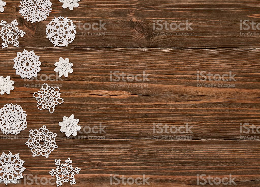 Snowflakes Wood Background, Christmas Snow Flake Lace Decoration Wooden Planks stock photo