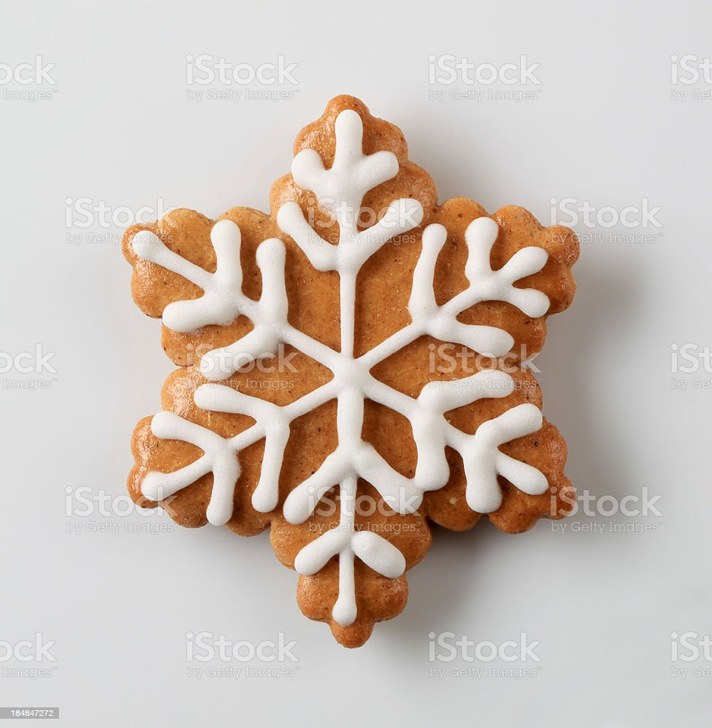 Snowflakeshaped gingerbread cookie royalty-free stock photo