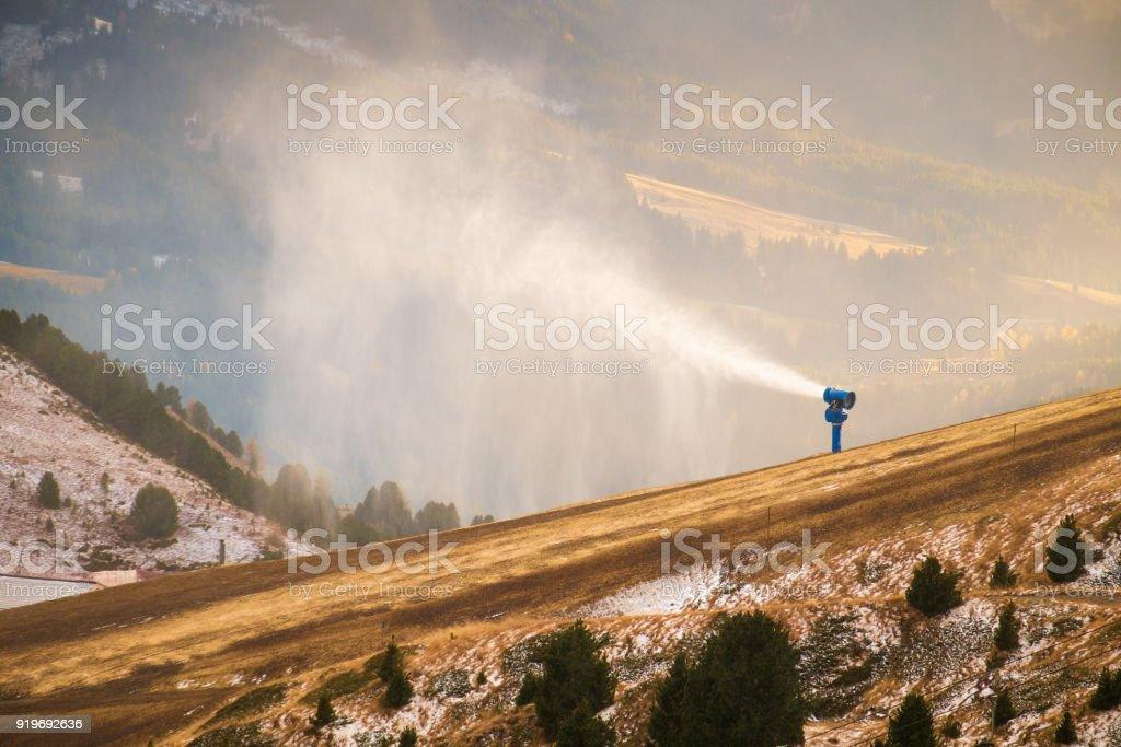 Snowgun in the dolomites stock photo