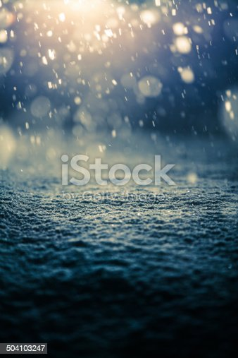 istock Snowing at Night and Backlight 504103247