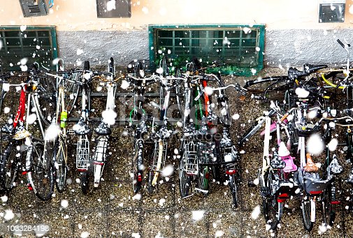 Bikes in country rack under winter snow
