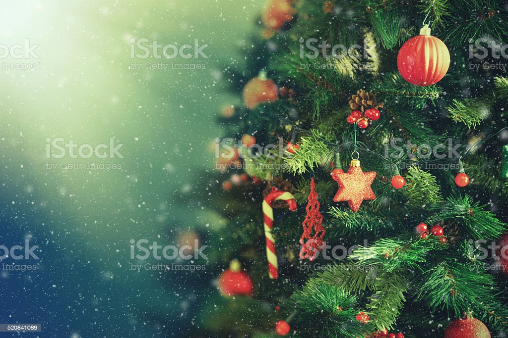 Snowing with Christmas tree stock photo