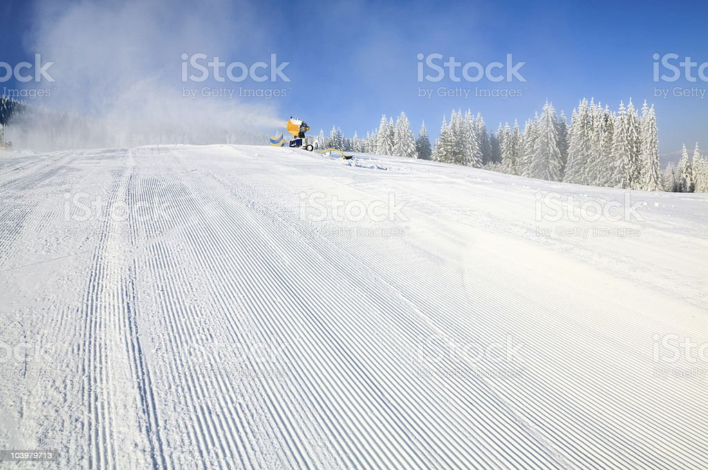 Snowmaking on a mountain ski resort royalty-free stock photo