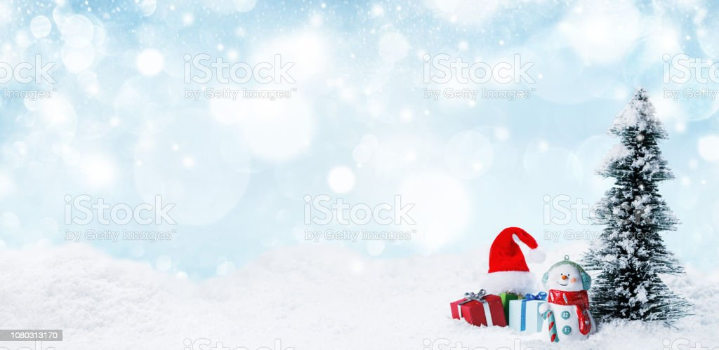 Snowman and Christmas decorations stock photo