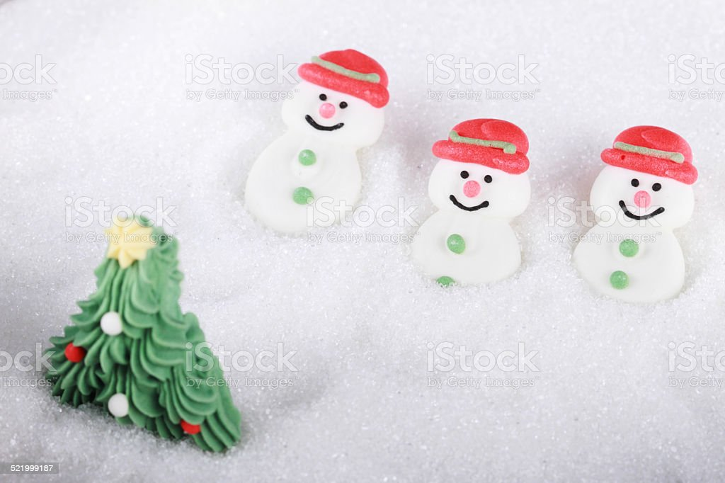 snowman and christmas tree stock photo