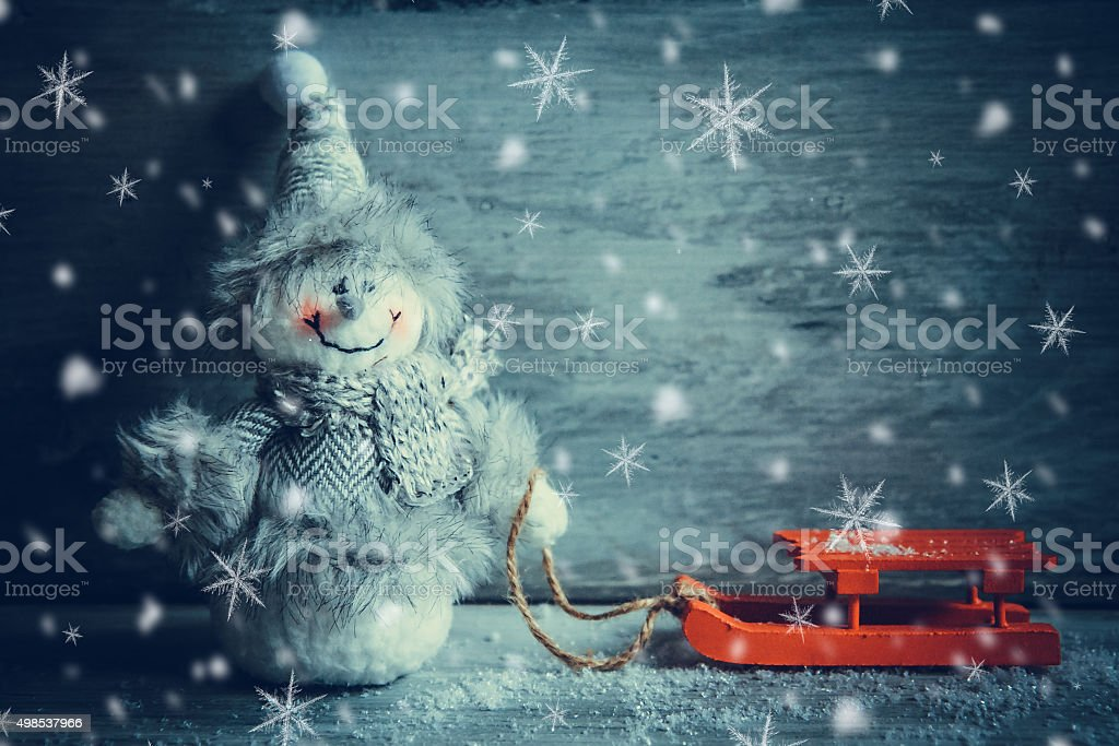 snowman and sled stock photo