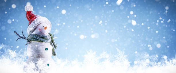 Snowman and Snowing Background stock photo