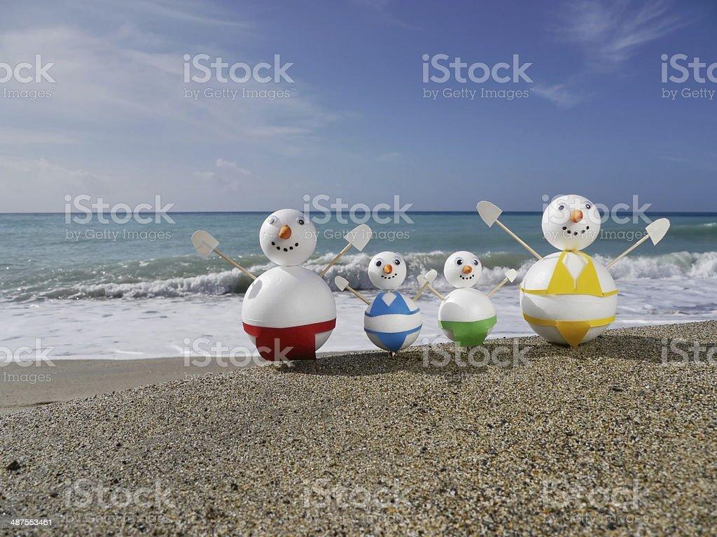 snowman beach vacation stock photo