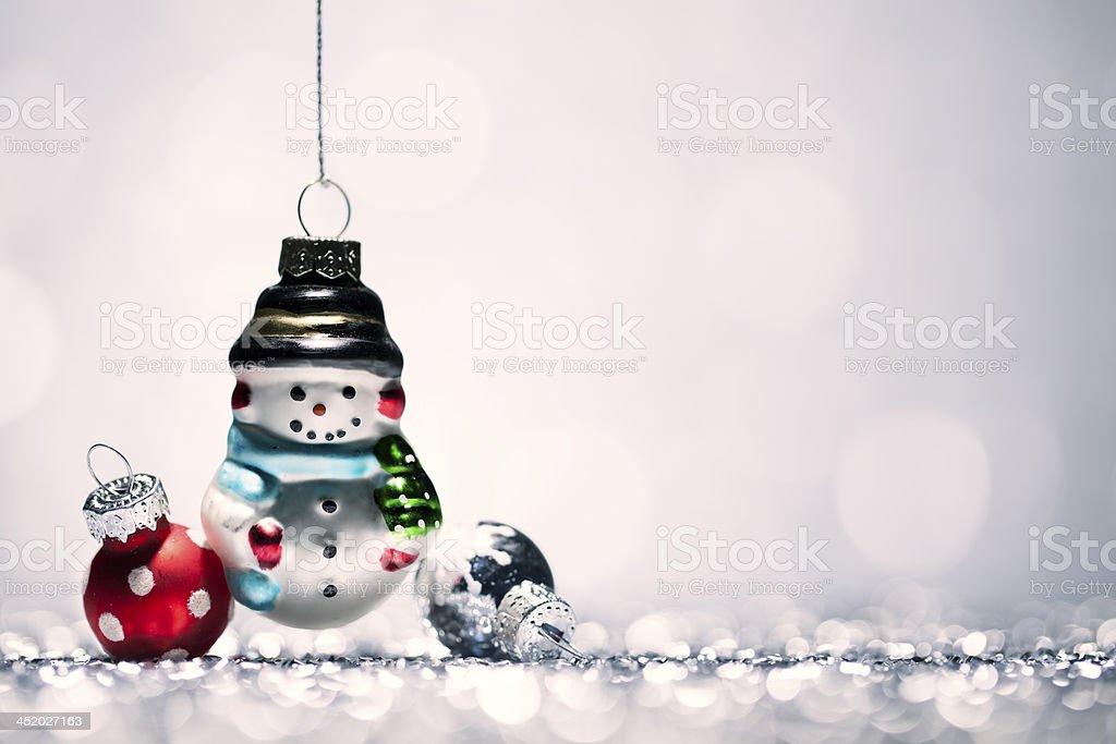 Snowman - Christmas Decoration Bauble Glitter Bokeh Winter Gold royalty-free stock photo