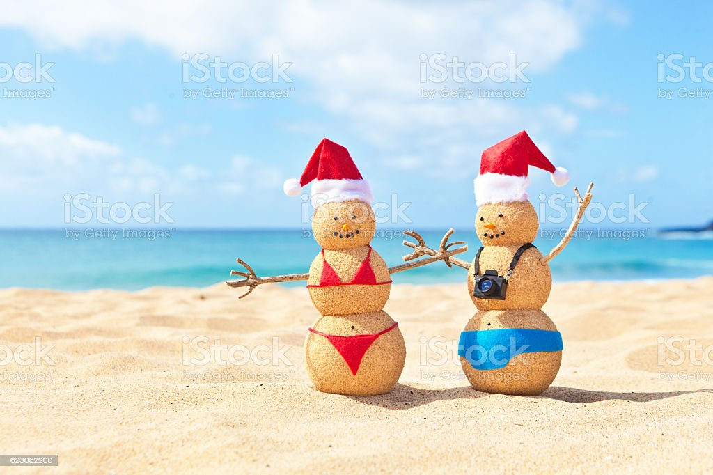 Christmas Beach.Snowman Couple Wearing Santa Hats On Christmas Winter Beach Vacation Stock Photo Download Image Now