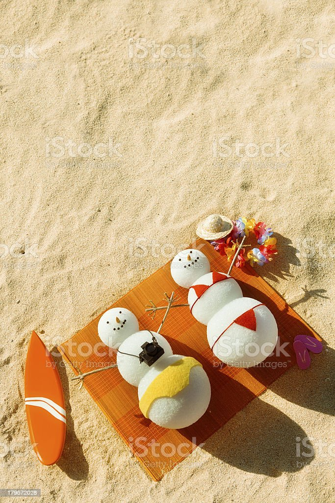 Snowman Couple Winter Vacation in Tropical Beach Paradise stock photo