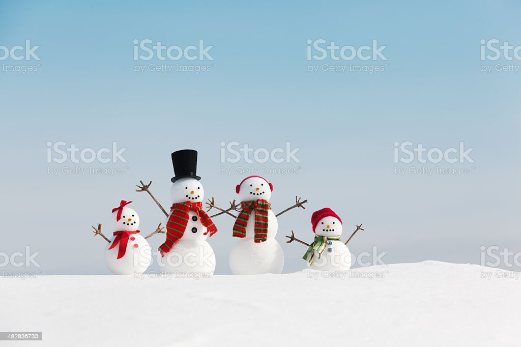 Snowman Family Christmas with Blue Sky Copy Space Horizontal stock photo