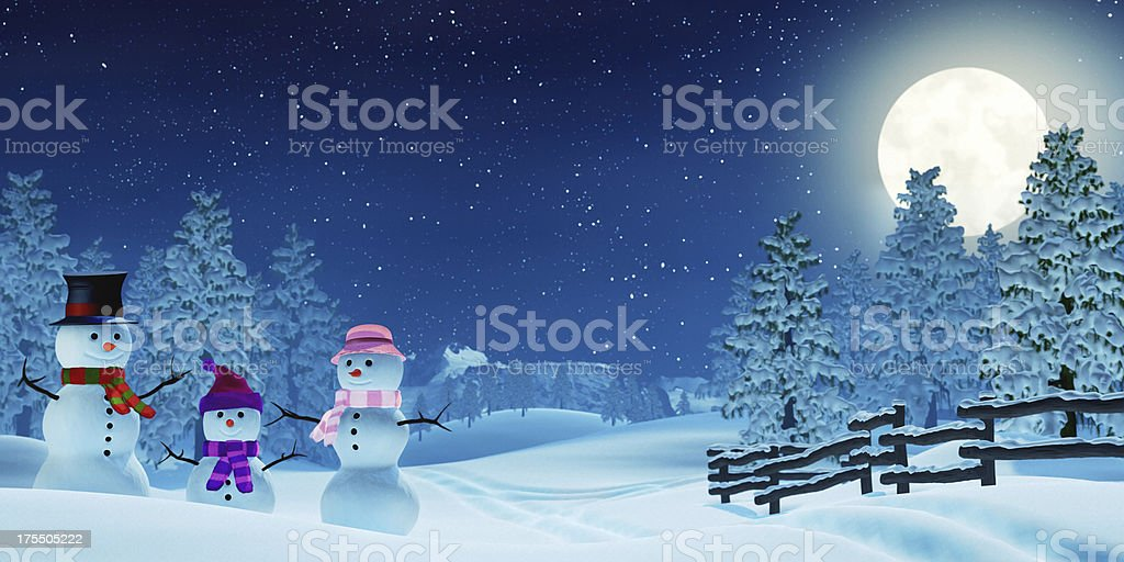 Snowman family in a moonlit winter landscape at night royalty-free stock photo