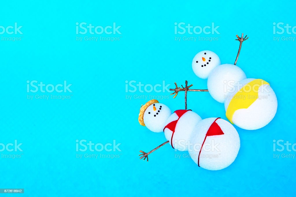 Snowman Family Winter Vacation on Tropical Swimming of Cancun Mexico stock photo