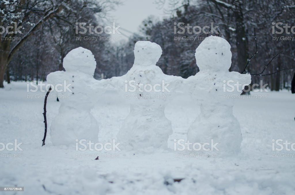 snowman figure in winter time in the park stock photo