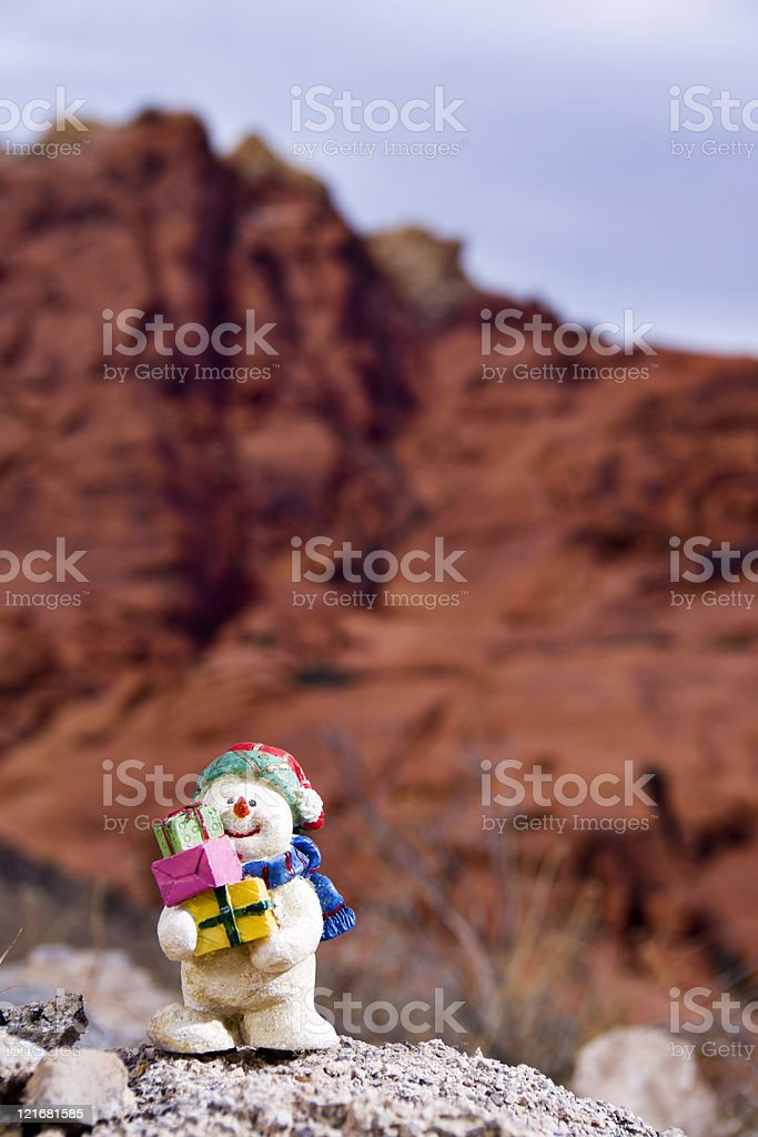 Snowman Figurine and Sandstone Hills royalty-free stock photo