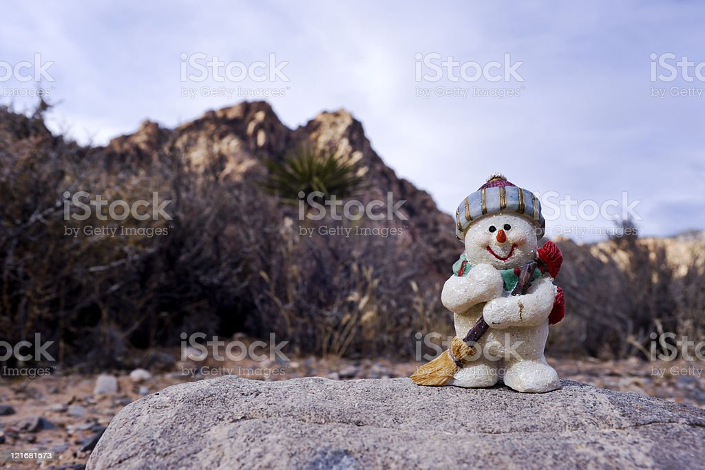 Snowman Figurine, Desert Plants and Sandstone Hills royalty-free stock photo
