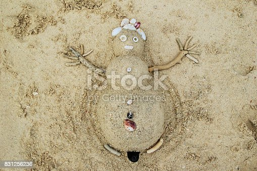 Travel to Phi-Phi island, Thailand. A snowman from sand and seashells on a beach.