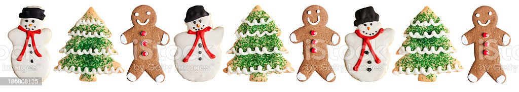 Snowman, Ginger Bread Man and Christmas Tree Cookies on White royalty-free stock photo