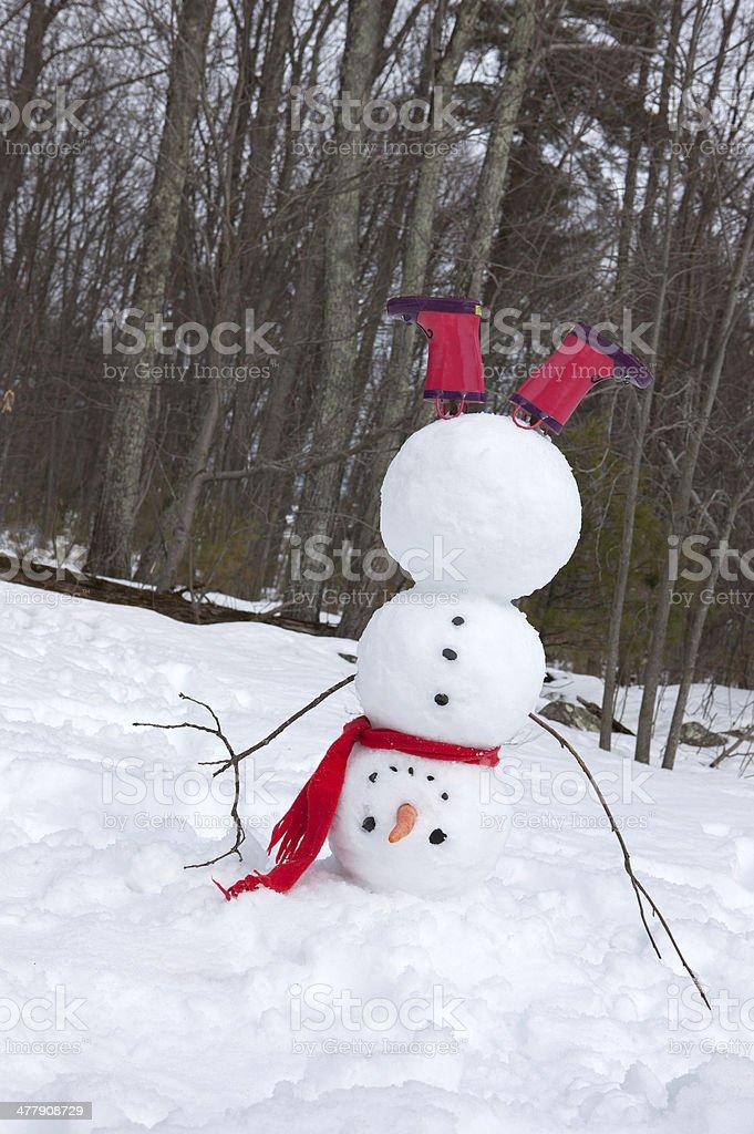 Snowman headstand stock photo