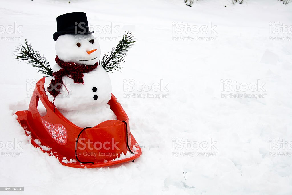 Snowman in Sled - copy space royalty-free stock photo