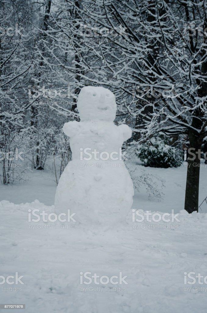 snowman in winter park full of snow stock photo