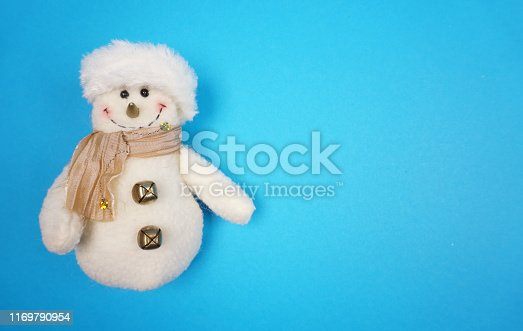 Snowman in winter setting,Christmas at blue background. with copy space for your own text