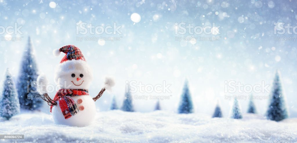 Snowman In Wintry Landscape stock photo